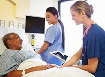 Woman in hospital doctors using tech