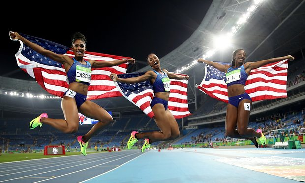 The USA's Brianna Rollins, Nia Ali and Kristi Castlin celebrate after they won gold, silver and bronze in the women's 100m hurdles final respectively. Photograph: Cameron Spencer/Getty Images