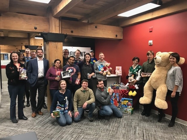 The entire perficient team with toys