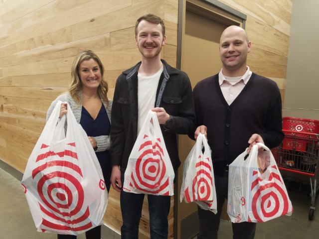 Pictures of Perficient employees at with Target bags