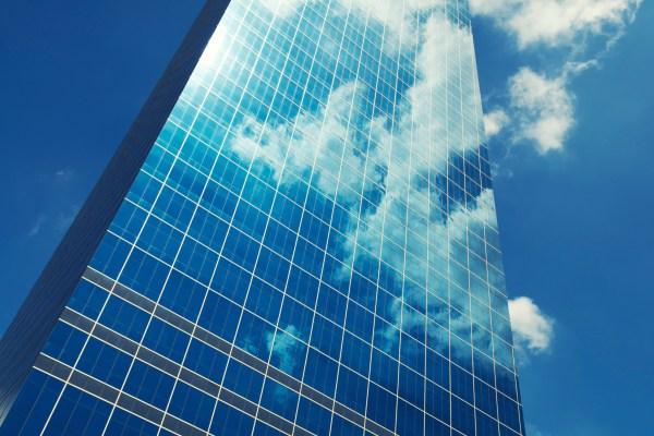 Sleek Glass Office Skyscraper Blue Sky Business Reflection