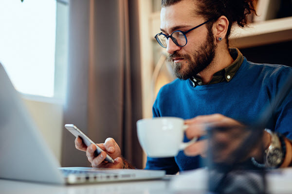 Blogging Man Table Cellphone