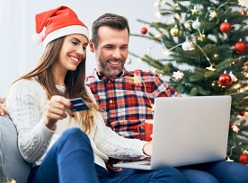 A couple doing online shopping during the holiday season