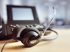 Headset Headphones And Telephone In Call Center