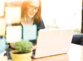 Woman Using Laptop, Smiling