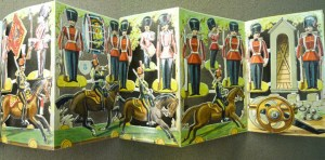 """Five-leaf accordion-fold with toy soldiers for readers to cut out, assemble, and arrange in """"innumerable tableaux."""""""