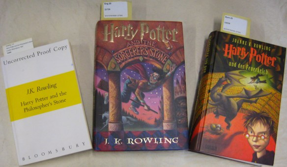A few Harry Potter copies housed at the Cotsen Children's Library. From left to right: an uncorrected proof (Cotsen 52989); first American edition (Cotsen 21739); a German translation (Cotsen 16930).