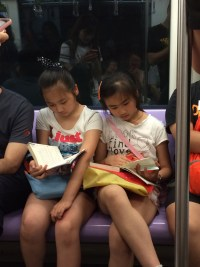 young readers in the subway, Shanghai