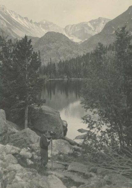 A Photographer with His Camera in the Rocky Mountain National Park, Colorado.