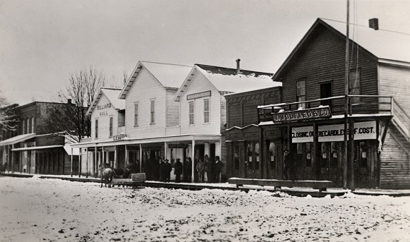 Main St. from S.E. Corner of Water St., 1880.