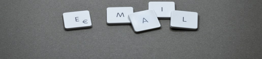 Email written in white keyboard tiles.