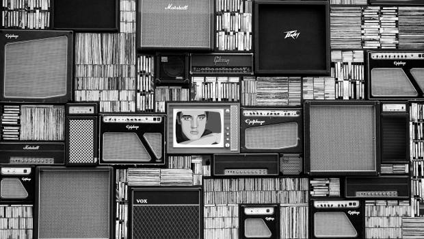 Black and white old tvs, magazines etc