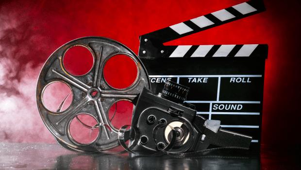 Clapper board, film reel and camera