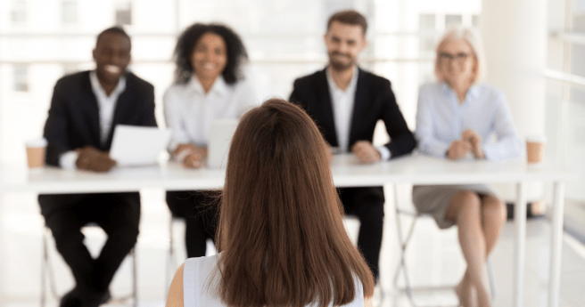 Person sat opposite an interview panel