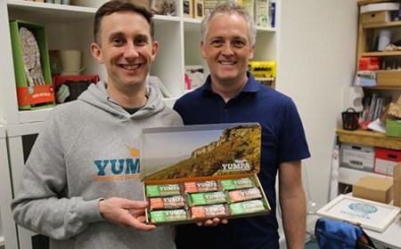 Tony Askins (Yumpa Bars) and John Kirkby (SHU's Design Futures) holding a selection of their cricket flour energy bars