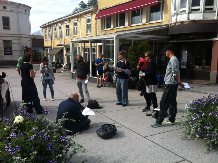 An image of the group preparing for a public reading in the town square of Ekenas/Tammisaari, Finland for 'Replay', courtesy of Joanne Lee