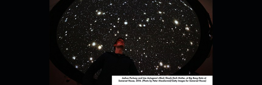LONDON, ENGLAND - DECEMBER 02: A member of staff looks up at the 'Black Shoals: Dark Matter' projection at the Big Bang Data exhibition at Somerset House on December 2, 2015 in London, England. The projection displays stars which represent live stock market activity. The show highlights the data explosion that's radically transforming our lives. It opens on December 3, 2015 and runs until February 28, 2016 at Somerset House. (Photo by Peter Macdiarmid/Getty Images for Somerset House)