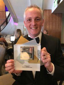 Creative Director John Kirkby collects the award