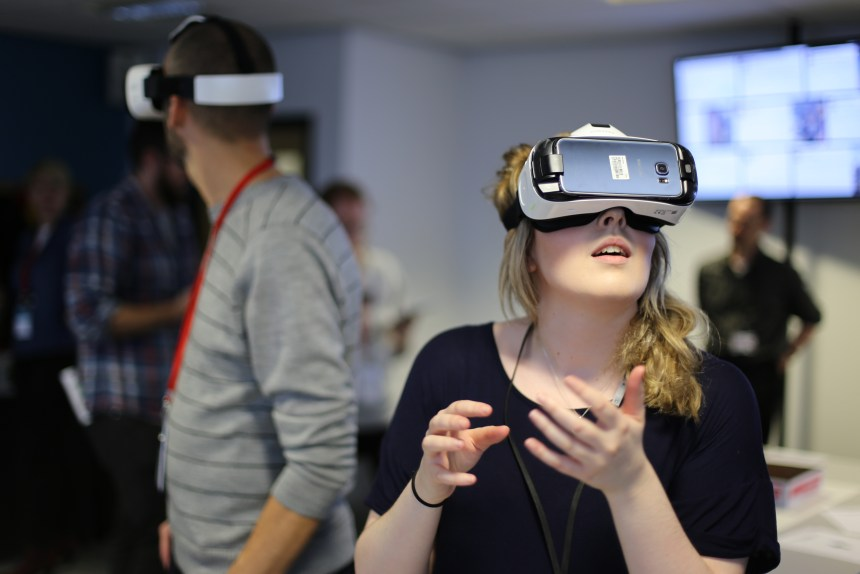A conference visitor using virtual reality technology
