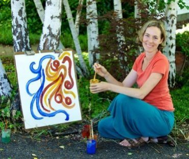 Leah painting with Earth Paints