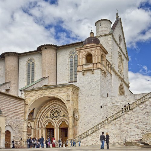 The side entrance to the Basilica of St Francis of Assisi from the lower piazza