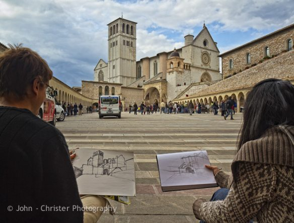 Young artists on the piazza of the Basilica of St Francis of Assisi