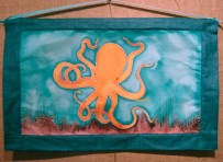Handpainted silk wall hanging with an endangered octopus design by Judy Elliott