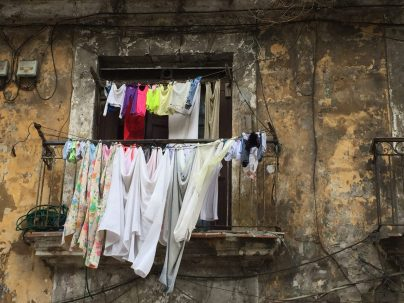 Image of clothers drying outside a window, by Judy Morris