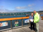 Port of Bandon Boardwalk Art Show 2016 judges Linda Mecum and Reg Pullen cruise the boardwalk.