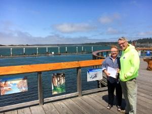 Port of Bandon Boardwalk Art Show 2016 judges Linda Mecum and Reg Pullen cruise the boardwalk.