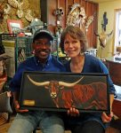 New Painting Named by Charles Sampson Artist Eugenia Talbott Adderson with famed pro rodeo Bull Rider Charles Sampson and her painting, Don't Call Me Buttercup