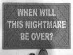 CoCA January 2018 exhibit ARTifACTs We Almost Didn't Make It featured image of a doormat with text: When Will this Nightmare Be Over?