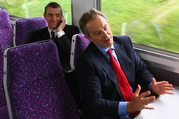 John McTernan (L), Director of Political Operatiosn, Prime Minister Tony Blair and author Ian Rankin (R) sit on a train from Barrhead to Kilmarnock, on April 26, 2007 in Scotland.