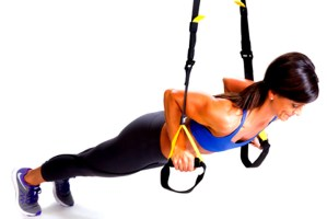 Push-ups on TRX suspension trainer.