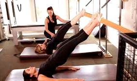 Train with a personal trainer on Pilates Reformer