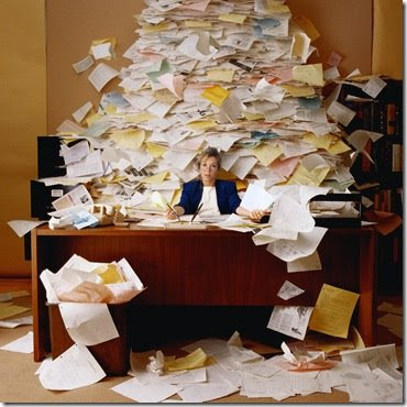 Image result for woman with stacks of paper