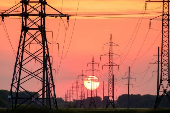 Overhead power lines at sunset