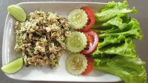 Laarb, also known as 'Larp', a spicy pork dish that is rolled up in lettuce leaves