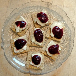 plum butter & goat cheese on Cracked Black Pepper Triscuits