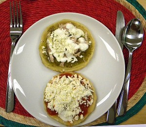 two types of picaditas, one with salsa verde and one with salsa roja