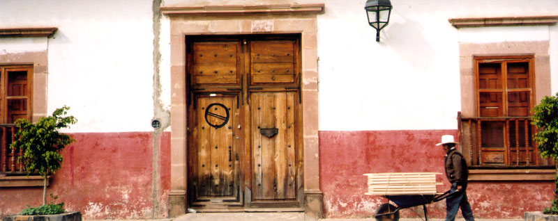 typical Patzcuaro wall with door & shuttered windows