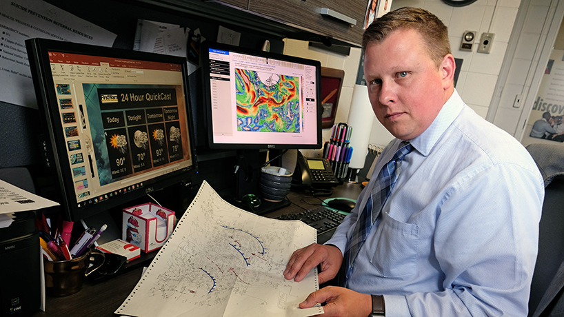 Nick Palisch's first passion was meteorology and he wakes at 4:30 a.m. to put together a forecast for community newspapers and his Facebook page, Firstwarn Weather. (Photo by August Jennewein)