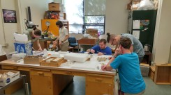 Rebecca Terry, Assistant Professor at Oregon State University, and three students learning how to properly conserve and stabilize Pleistocene fossils