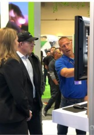 Surprise guest Michael Dell stopped by the Solutions Exchange to check out demos of what's new from the networking and security business unit demoed by Chris McCain