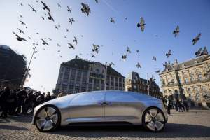 The Mercedes Benz F 015 self-driving stands on March 13, 2016 at the Dam square in Amsterdam. This model is presented for the first time in Europe. - Netherlands OUT / AFP / ANP / Bart Maat