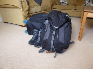 Suitcase and rucksack packed ready for travelling.