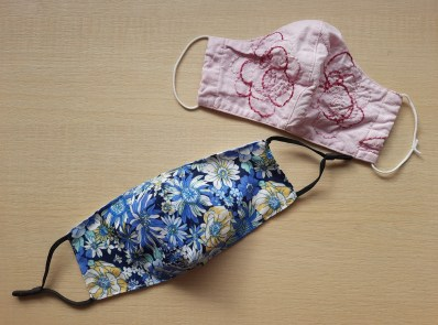two face masks - one blue floral and one pink floral