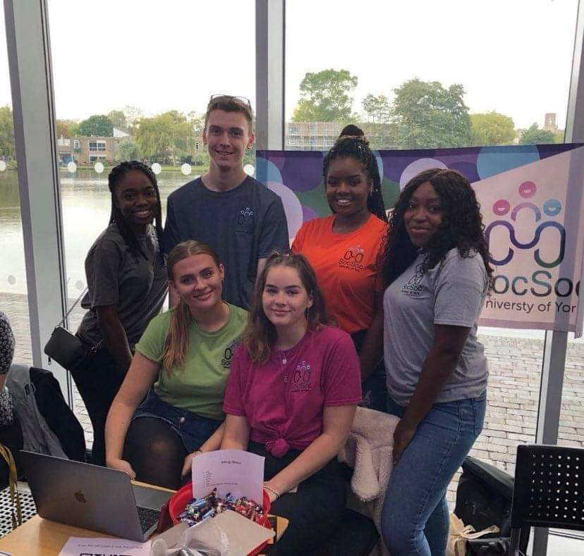 Zoe and her Sociology Society friends at the Freshers' Fair stand