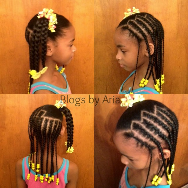 yellow beads and bows in this simple young girls hairstyle that's very cute!