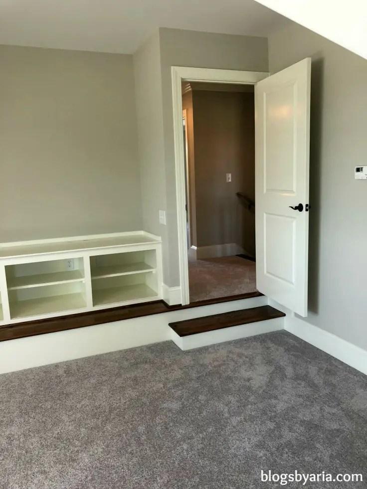 bonus room with built-ins for media storage